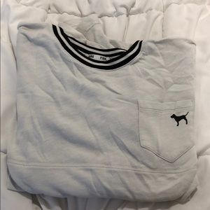 white crew neck with black lettering and stripes